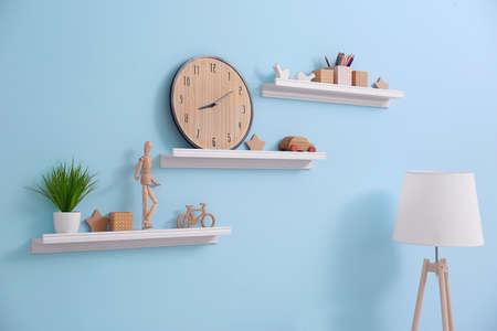 Shelves with home decor in modern room Foto de archivo