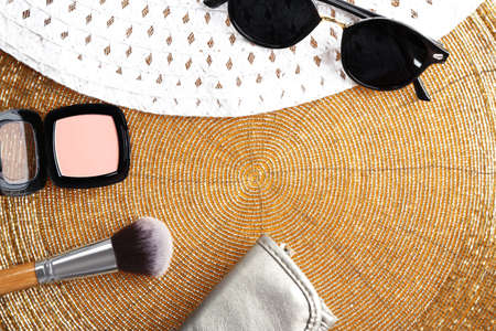 Set of decorative cosmetics and accessories on golden background Stock Photo - 96194713