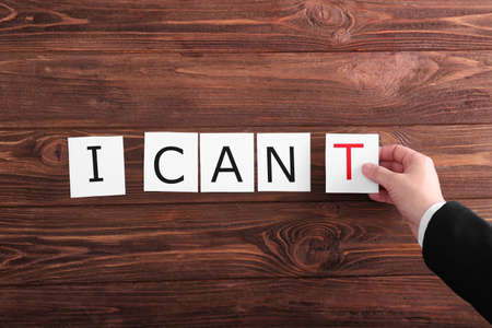 Human hand turning phrase I CANT to phrase I CAN Stok Fotoğraf - 96194337