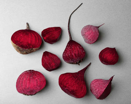 Fresh beetroot cut half on grey background, top view