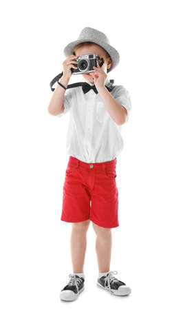 Little boy with vintage camera isolated on white
