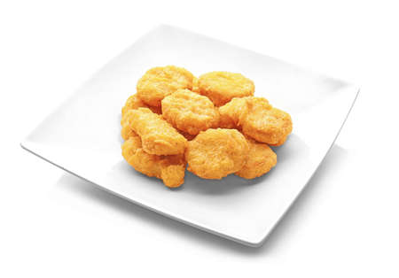 Tasty chicken nuggets on plate, isolated on white background
