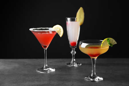 Delicious cocktails on gray table Stock Photo
