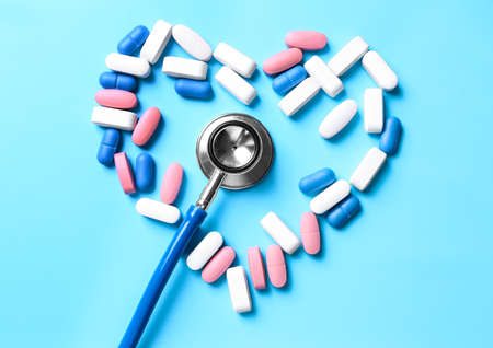 Stethoscope with pills on table