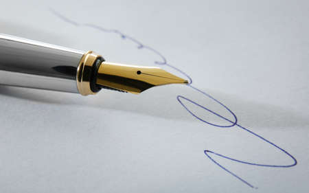 Notary public signature and fountain pen, close up view