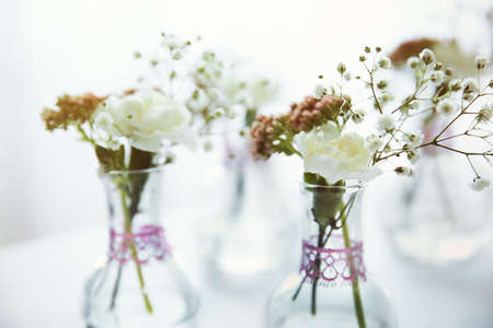 Mini Glass Vases With Flowers On Table Stock Photo Picture And