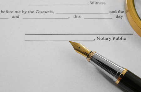 Fountain pen on testament and last will, close up view Stock Photo