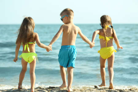 Cute kids having fun on beach Stock Photo