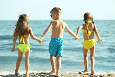 Cute kids having fun on beach