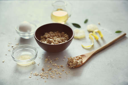 Natural scrub of oatmeal, olive oil and lemon on light background Stock Photo