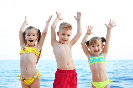 Cute kids having fun on beach