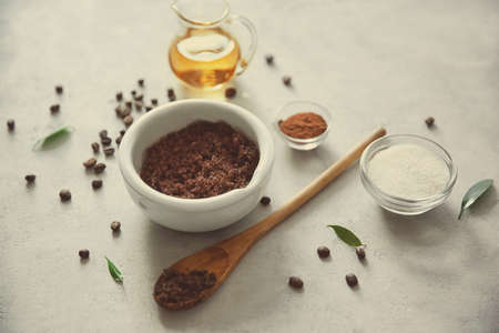 Natural scrub of sugar and coffee on light background