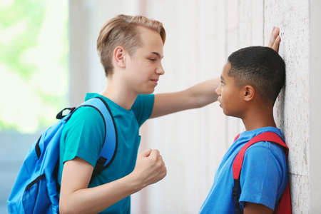 Boy threatening schoolmate