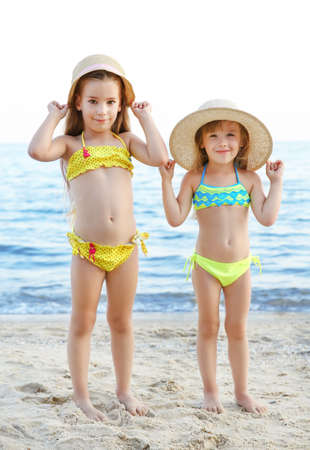 Cute girls having fun on beach