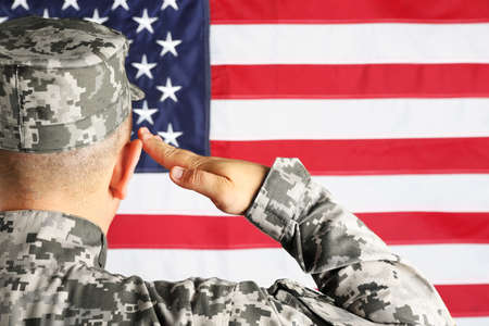 Male army soldier on American flag background