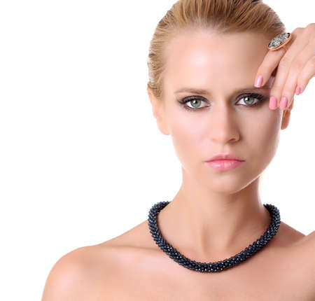 Young woman with stylish necklace on white background