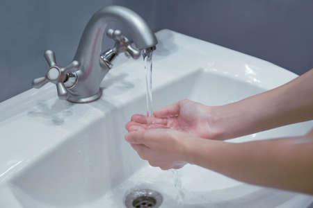 Washing hands in bathroom