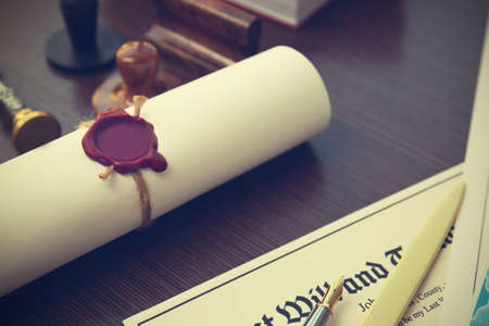 Tied scroll with old notarial wax seal and stamp on table Stock Photo - 96512504