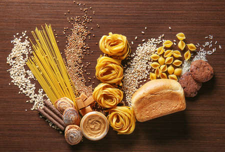 Set of products with complex carbohydrates on wooden background