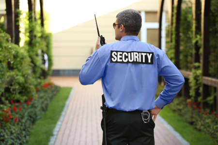 Male security guard protecting house outdoor