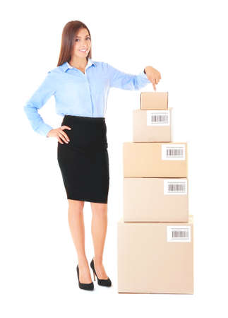 Beautiful businesswoman with boxes on white background Imagens
