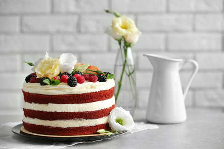 Delicious cake with fruit and berries decoration on gray table Stock Photo