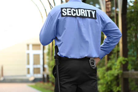 Male security guard protecting house outdoor Foto de archivo - 96451639