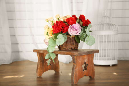 Beautiful flowers on a wooden chair