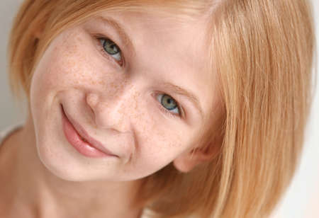 Closeup portrait of attractive teenager girl with freckles