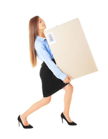 Beautiful businesswoman carrying heavy box on white background