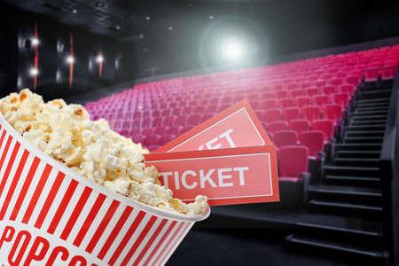 Tasty popcorn and tickets in cinema