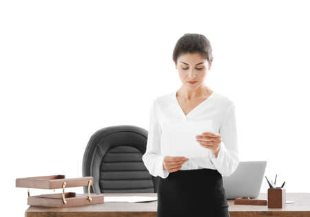 Successful mature businesswoman with documents in her office