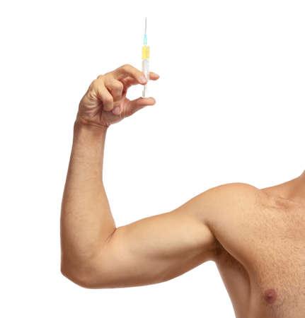 Sportsman hand  holding syringe on white background