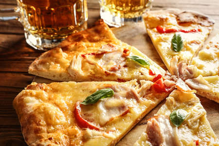 Tasty pizza with beer, closeup