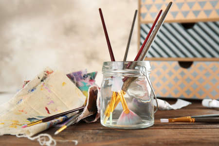 Brushes in a jar with water