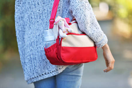 Woman with baby bag on street