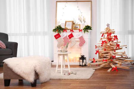 Creative Christmas tree in living room interior