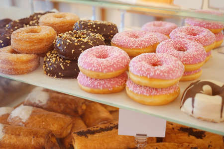 Delicious donuts on store shelves closeup Stockfoto - 97092497