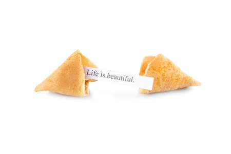 Fortune cookie with message LIFE IS BEAUTIFUL isolated on white Stock Photo
