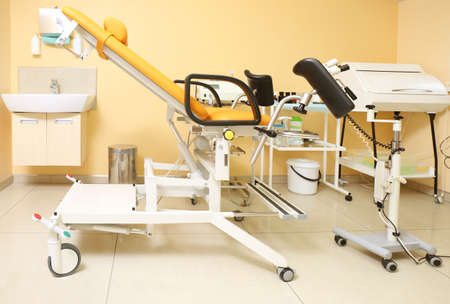Gynecological room with chair and equipment Stock Photo