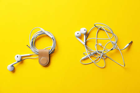 Usage example of multifunctional magnetic clip as earphones cable holder Stock Photo