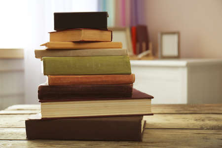 Pile of books on table in the room