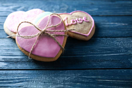 Heart shaped cookies on wooden background, closeup