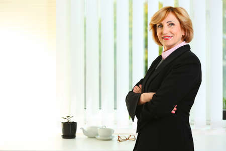 Senior successful businesswoman in office