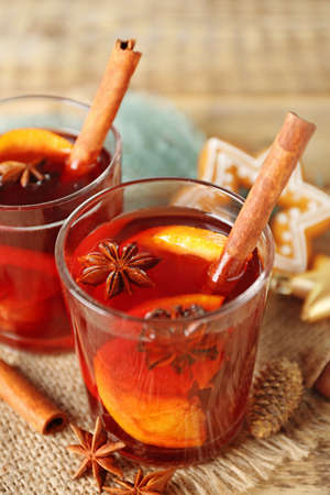 Glass of delicious Christmas mulled wine on sackcloth, closeup Stock Photo