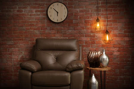 Modern room interior with lamp on brick wall background