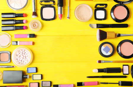 Flat lay of makeup cosmetics on yellow background 写真素材