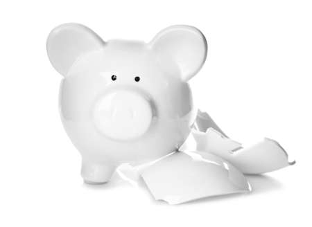 Broken piggy bank on white background