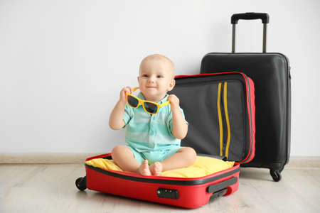 Baby sitting in suitcase