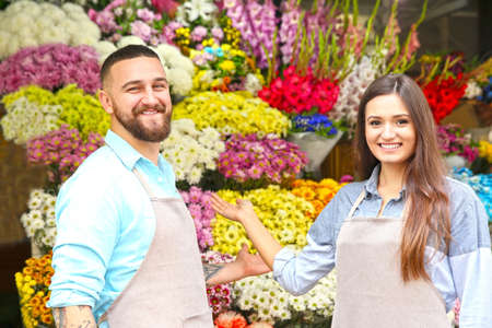 Male and female florists in flower shop